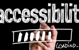 """schwarzes Rechteck, Bild mit Hand, die einen Ladebalken unter dem Schriftzug """"Accessibility"""" zeigt. Credit: Canva"""